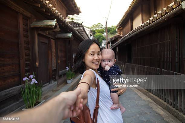 POV Portrait of a mother holding a baby