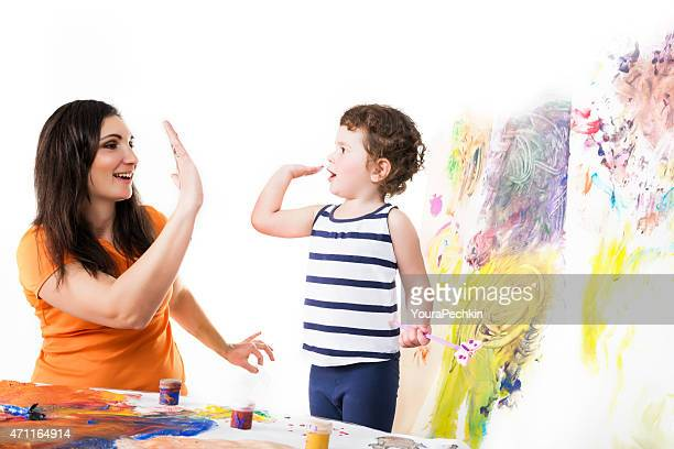 Portrait of a mother with a child playing in artists