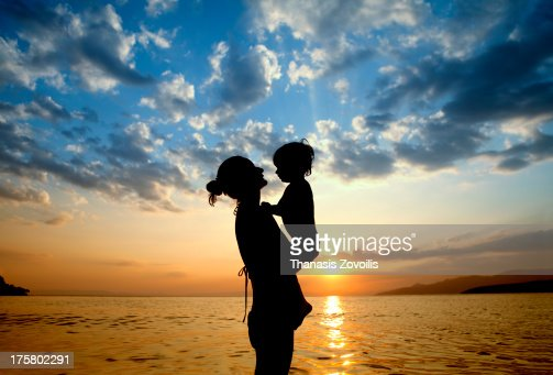 Portrait of a mother with her kid on the beach : Stock Photo