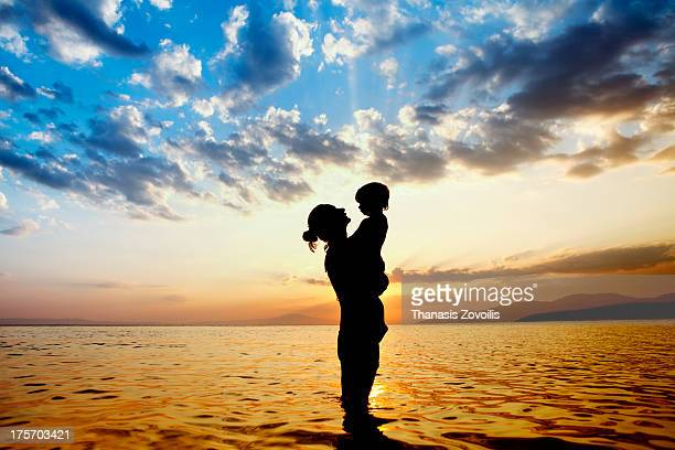 Portrait of a mother with her son on the beach