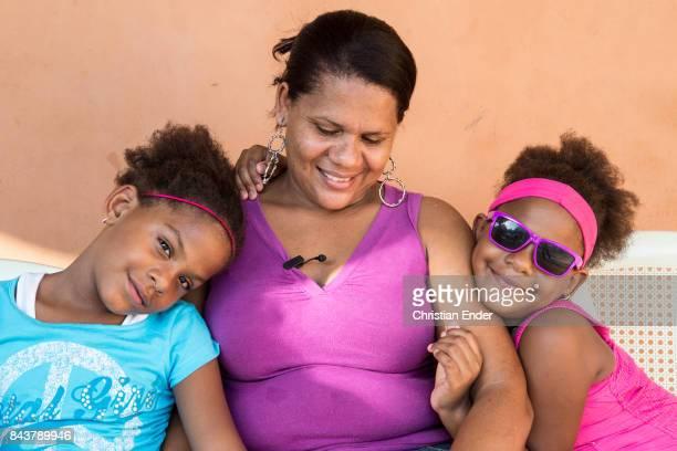 Santa Domingo Dominican Republic November 30 2012 Portrait of a mother with her twins in the poor neighbourhood 'Los Alcarrizos' in Santa Domingo