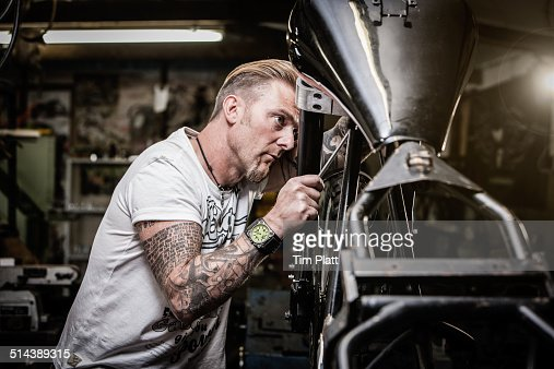 Portrait Of A Motorcycle Mechanic At Work Stock Photo