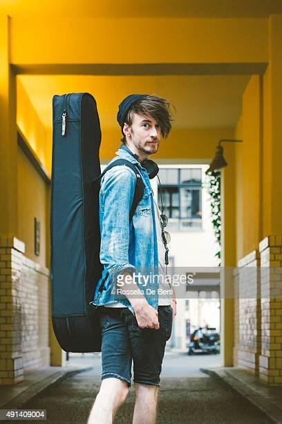 Portrait Of A Musician Walking Down The Street