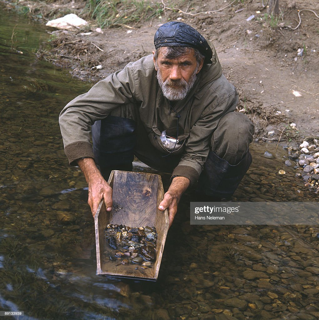Portrait of a native Siberian man panning for gold, Ural River, Ural Mountains, Siberia, Russia