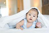 Portrait of a newborn Asian baby on the bedPortrait of a newborn Asian baby on the bed: SONY A7