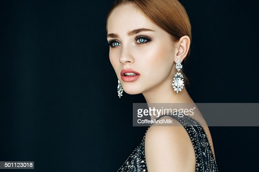 Portrait of a nice looking woman with beautiful earings
