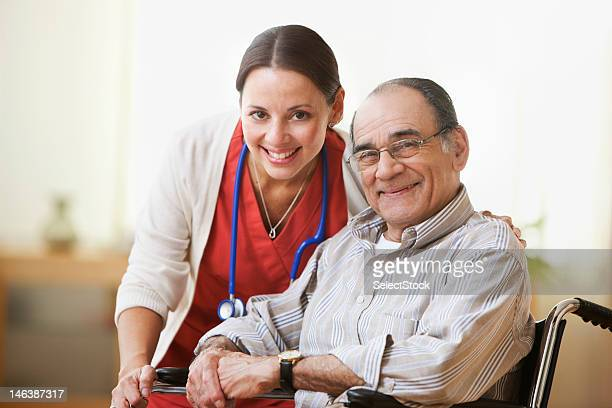 Portrait of a nurse and an elderly man smiling