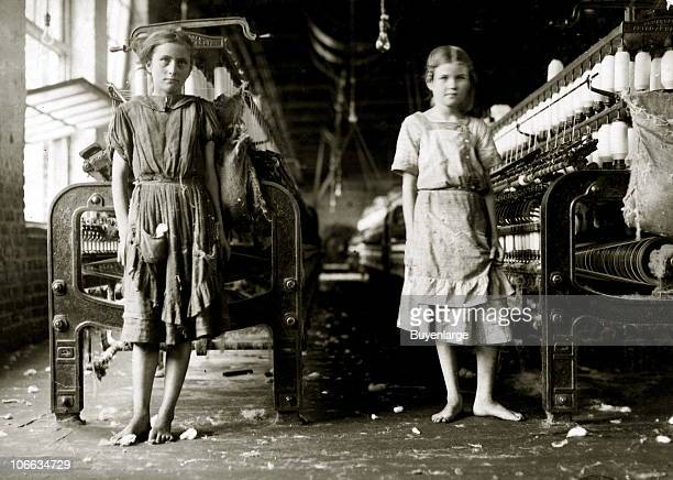 Portrait of a pair of barefoot young girls who work as spinners in an unspecified cotton mill 1911
