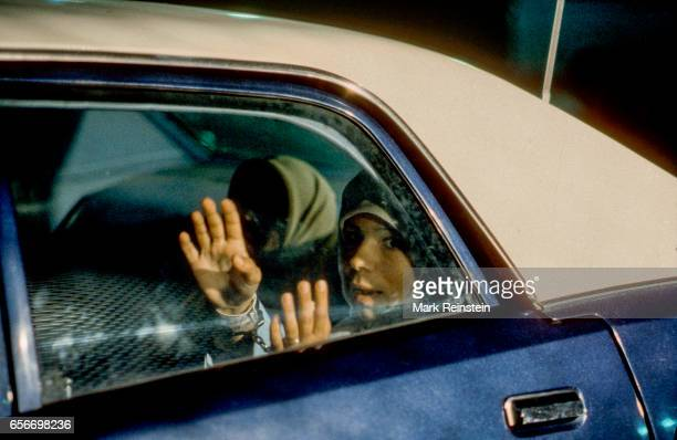 Portrait of a pair of Iranian students sit handcuffed in the backseat of a police car Washington DC 1979 The two men arrested by immigration agents...