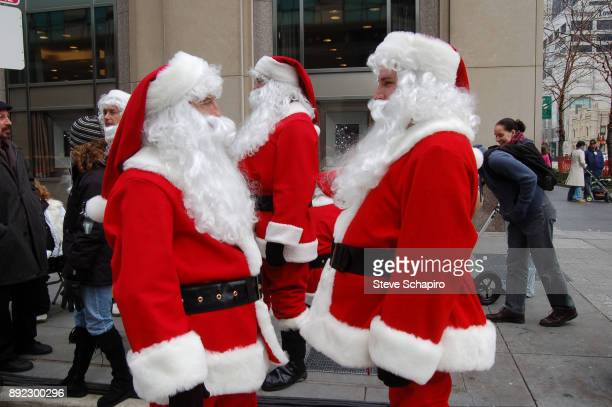 Portrait of a pair of unidentified men both dressed in Santa Claus costumes stand face to face on a street Chicago Illinois January 7 2007 Other...