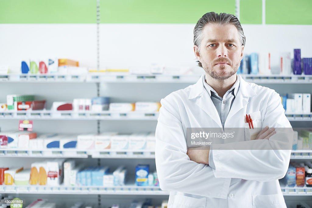 Portrait of a pharmacist in pharmacy : Stock Photo