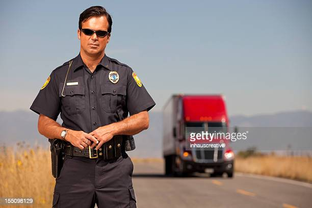 Portrait of a Police Officer and Cargo Truck