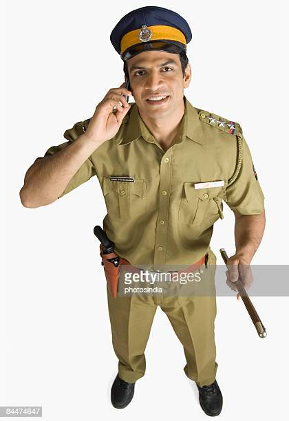 Portrait of a policeman talking on a mobile phone and smiling