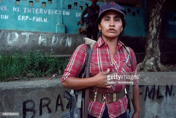 Portrait of a Popular Revolutionary Forces guerrilla as she stands in front of a Salvadoran government building occupied during an attack San Miguel...