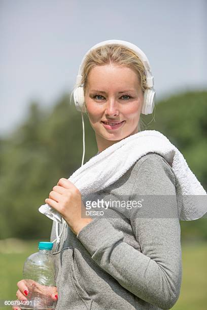 Portrait of a pretty blonde woman doing sport in park