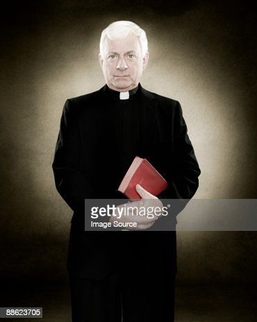 Portrait of a priest holding a bible