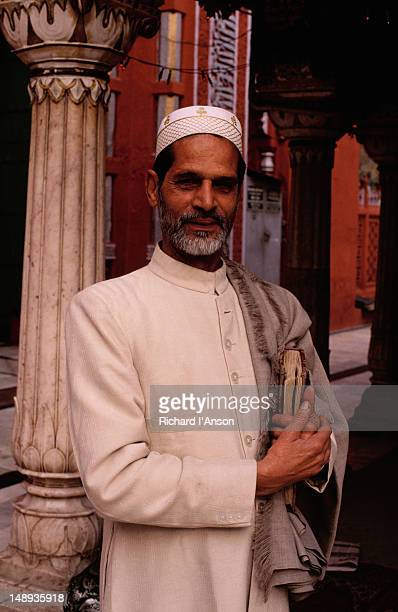 Portrait of a priest in front of the mosque at the shrine of Nizam-ud-din Chishti, a Muslim Sufi saint who died in 1325.