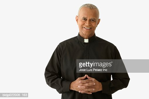 Portrait of a priest smiling