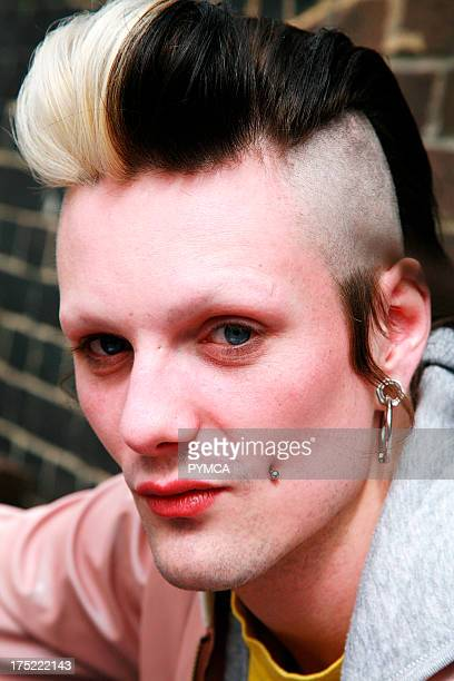 Portrait of a punk boy with a piercing on his cheek and a hairstyle UK 2006
