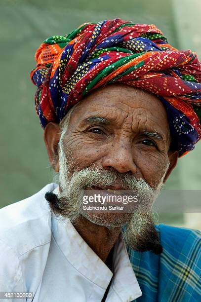 A portrait of a Rajasthani man with a long moustache