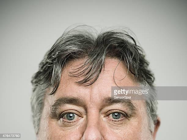 Portrait of a real english man looking at camera.