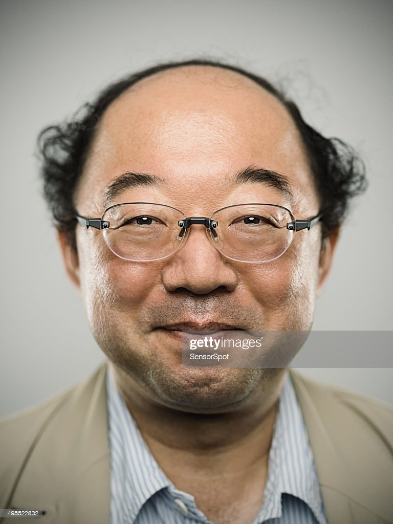 Portrait of a real happy japanese man with black hair.