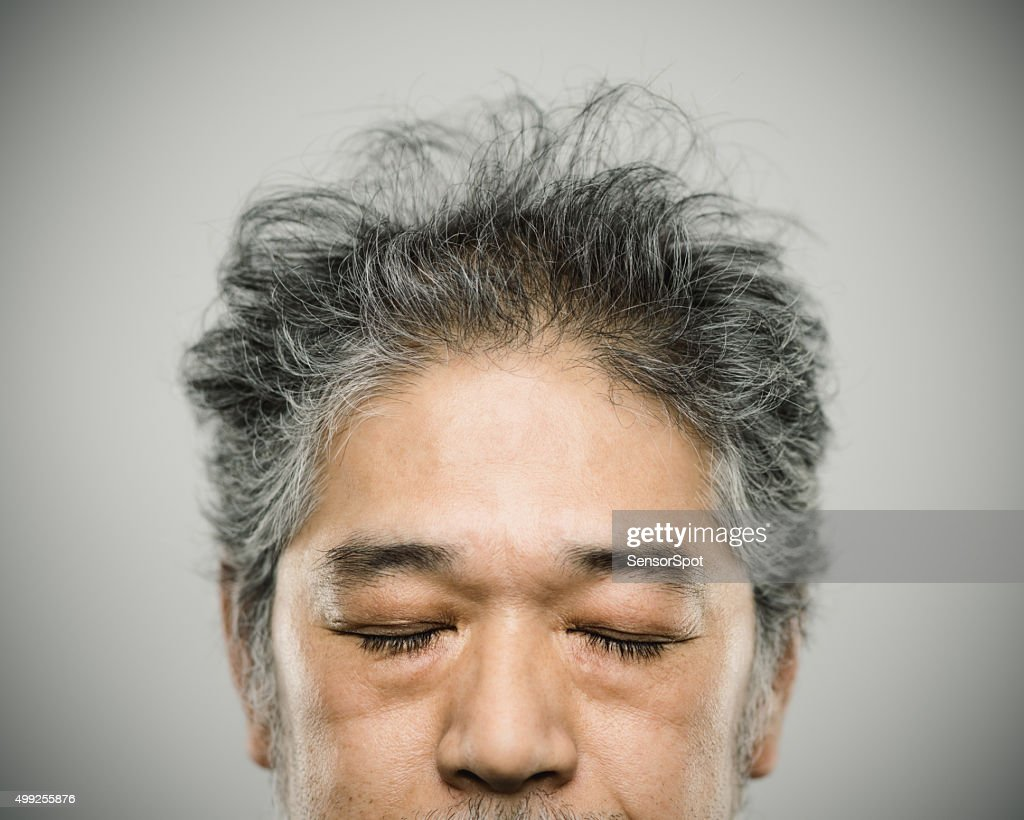 Portrait of a real japanese man with grey hair.