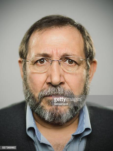 Portrait of a real spanish man with glasses and beard.