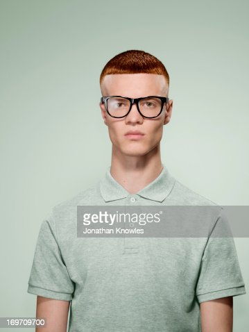Portrait of a red hair male with glasses on