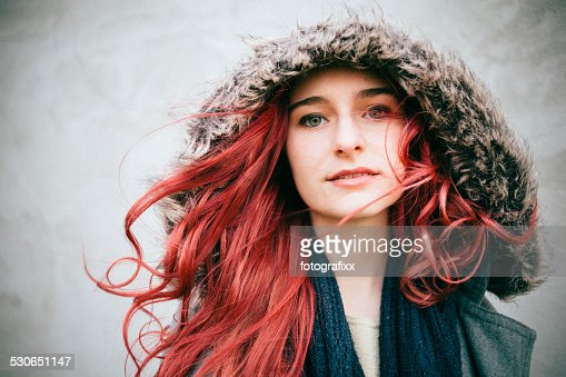 portrait of a redhead teenager girl, looking at camera
