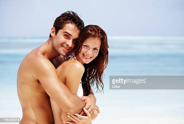 Portrait of a romantic young couple at the beach
