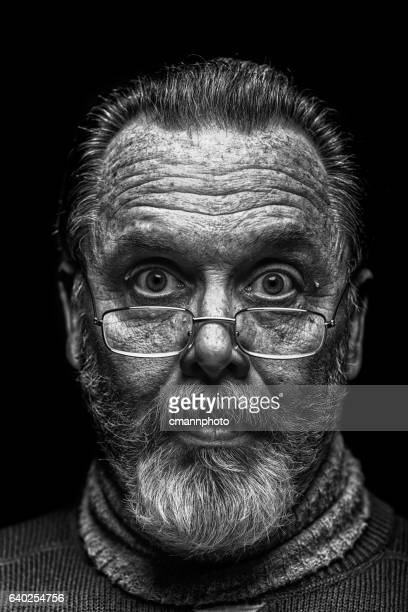 B&W portrait of a rugged looking middle-aged man with eyeglasses