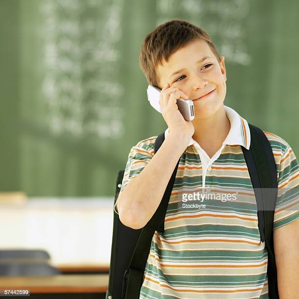 Portrait of a schoolboy (8-9) on a mobile phone