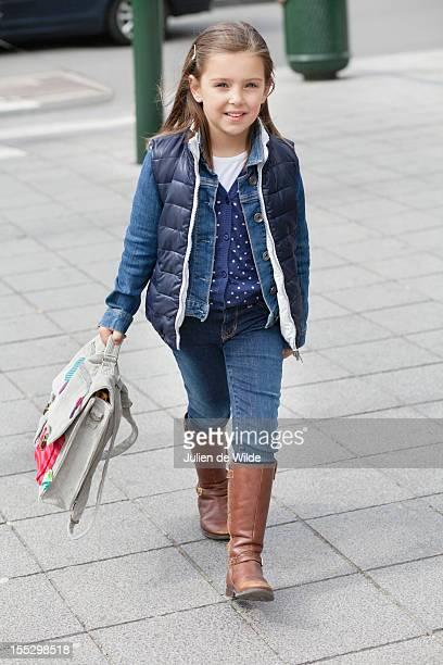 Portrait of a schoolgirl carrying schoolbag