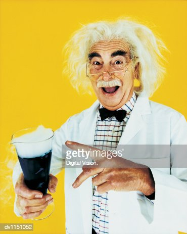 Portrait of a Scientist Pointing to a Flask of Smoking Chemicals : Stock Photo