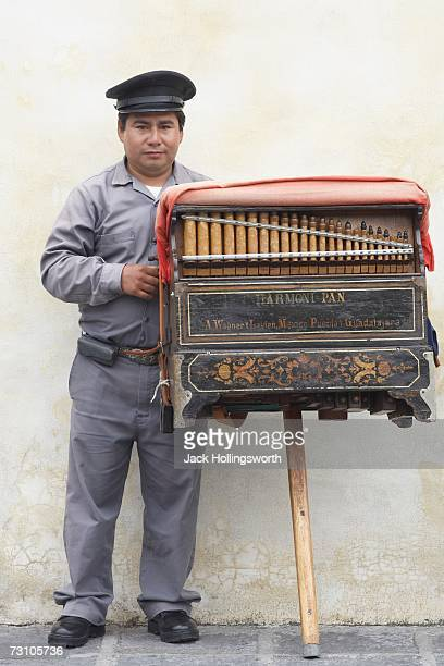 Portrait of a security guard holding a music box