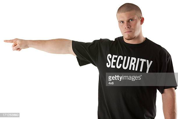 Portrait of a security guard pointing