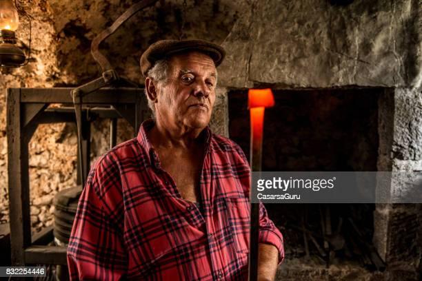 Portrait of a Senior Blacksmith Man