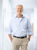 Portrait of casual senior businessman standing at office