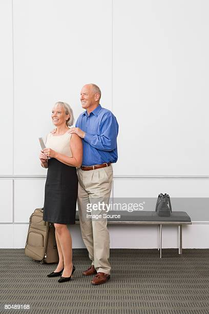 Portrait of a senior couple holding tickets