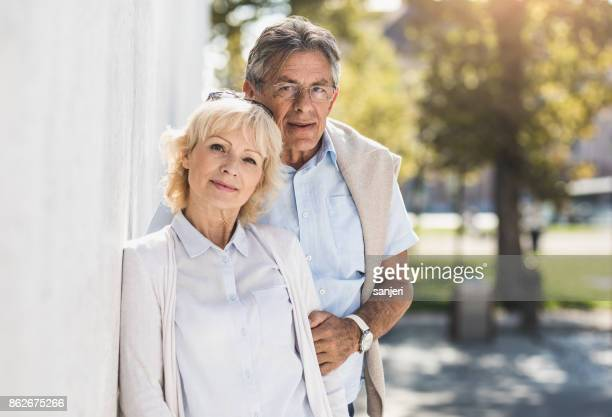 Portrait of a Senior Couple in Front a Wall