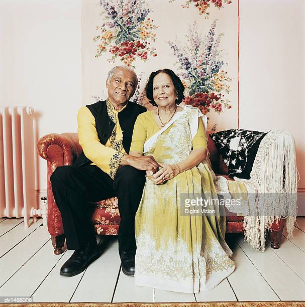 Portrait of a Senior Couple Sitting on a Sofa in Their Living Room