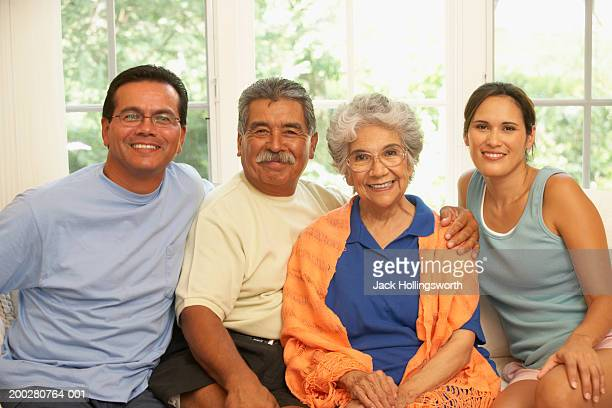 Portrait of a senior couple sitting with their son and daughter