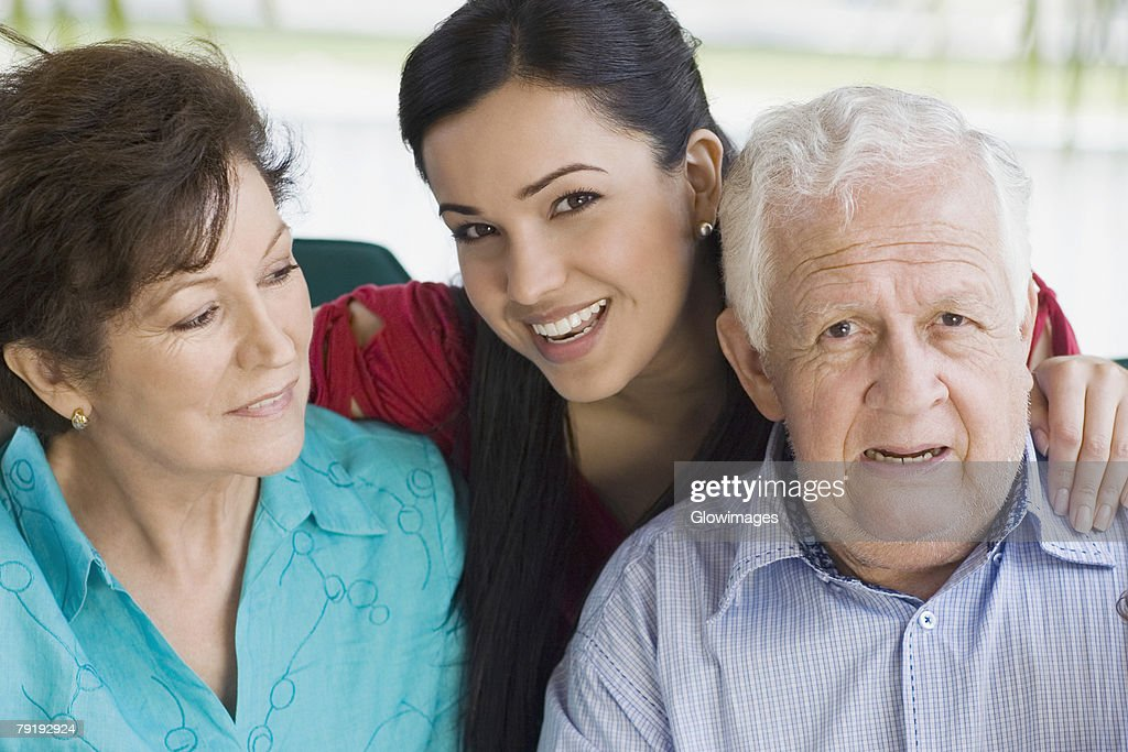 Portrait of a senior couple with their granddaughter : Stock Photo