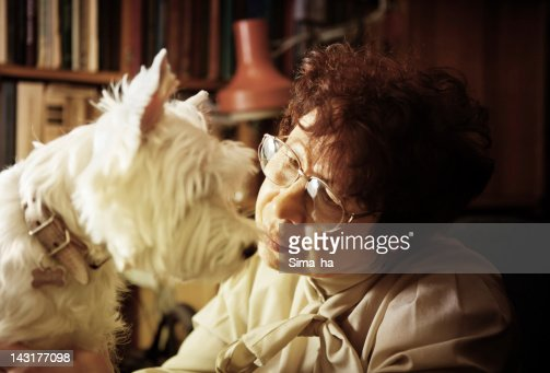 Portrait of a senior lady with her dog