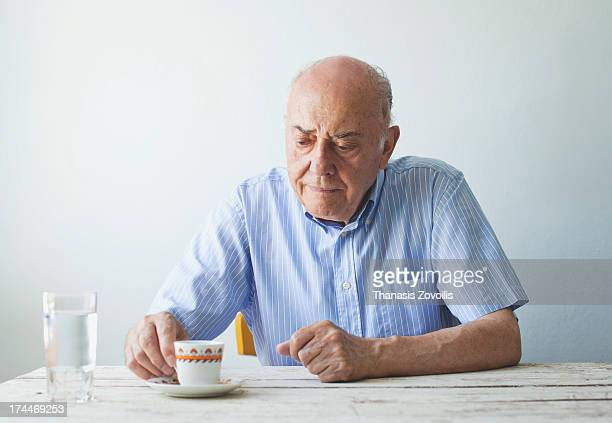 Portrait of a senior man drinking coffee