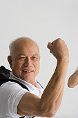 Portrait of a senior man flexing his muscle