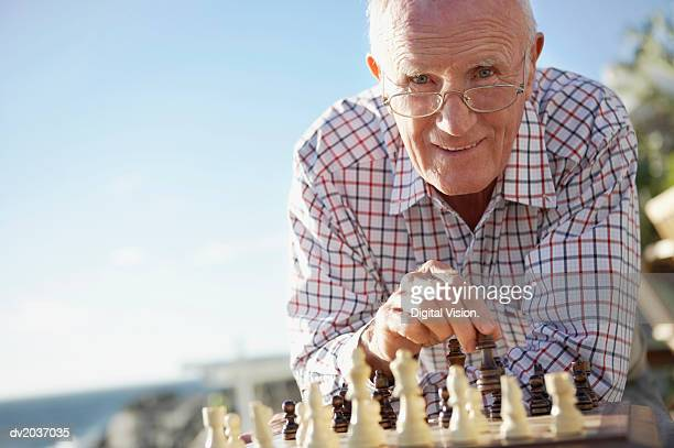 Portrait of a Senior Man Playing Chess