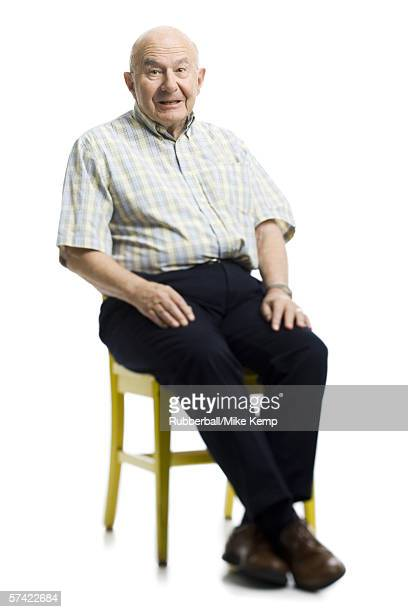 Portrait of a senior man sitting on a chair