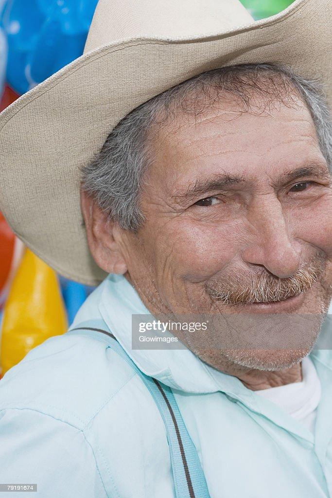 Portrait of a senior man smiling : Stock Photo